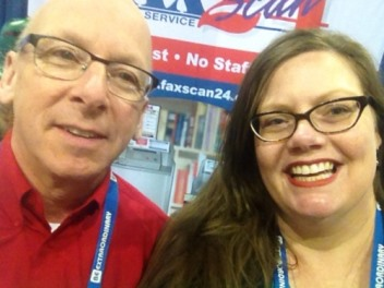 Prize-winner Amy Strohmer-Wood takes a selfie with the FaxScan24 Fax and Scan Service booth staff.