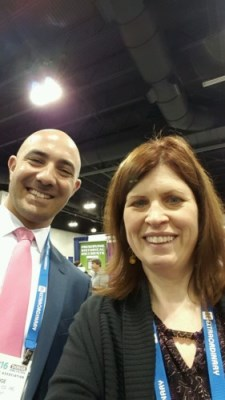 Prize-winner Marianne Malagon takes a selfie with Tim Hooge in the William S. Hein & Co., Inc. booth.