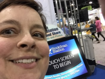Prize-winner Casandria Crane takes a selfie with a Today's Business Solutions simple scan station.